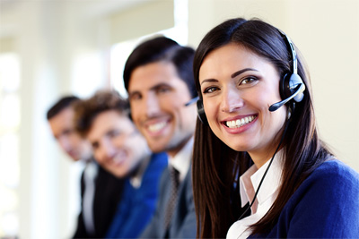 Cheerful young businesspeople and colleagues in a call center of